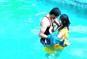 Lovers hot matter in swimming pool