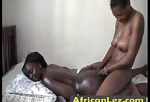 Busty black masseuse seduces other chick and lures her into hot lesbian sexl