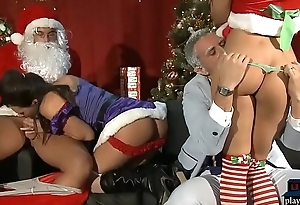 Latina chicks with big boobs fuck Santa and his helper