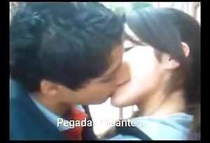Sexy girlfriend giving a kiss her boyfriend in a sensual identically