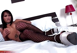 Ladyboy in black stockings masturbates chunky boner on the bed
