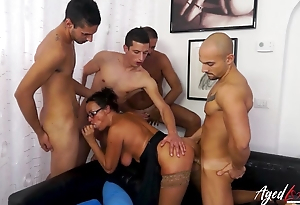 Age-old brunette adores group sex together with double penetration