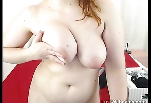 Chubby redhead toys her pussy above webcam