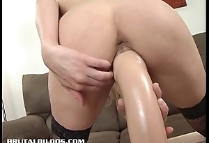 Big-busted blonde bounces up and down on a big brutal dildo